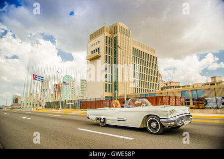 HAVANA, CUBA - AUGUST 30, 2015: The US embassy in the city of Havana, Cuba Old classic American cars used for taxi - Stock Photo