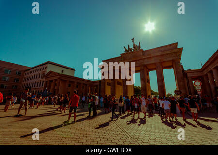 BERLIN, GERMANY - JUNE 06, 2015: Turists visiting Brandenburger gate in a nice sunny day, people walking around - Stock Photo