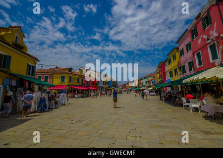 BURANO, ITALY - JUNE 14, 2015: Tourists great place to enjoy the summer and take some pictures of pinturesque Burano. - Stock Photo