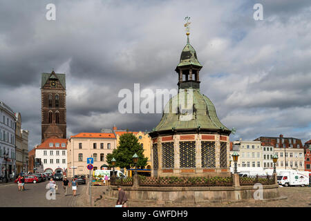 Market Square with the landmark waterworks or Wasserkunst and  St. Mary's Church tower, Hanseatic City of Wismar, - Stock Photo