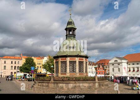 Market Square with the landmark waterworks or Wasserkunst, Hanseatic City of Wismar, Mecklenburg-Vorpommern, Germany - Stock Photo
