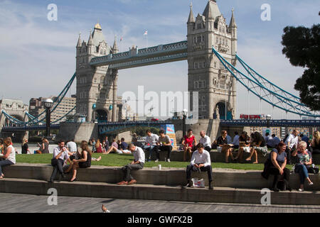 London UK. 13th September 2016 People enjoy the sunshine on London Riverside as London and Britain is expected to - Stock Photo
