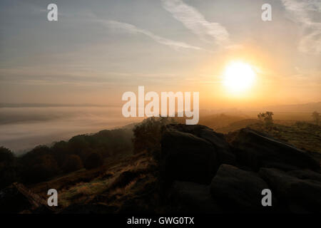 Leeds, UK. 13th September, 2016. Sunrise over Otley Chevin with low laying cloud down in the Wharfe valley. Credit: - Stock Photo