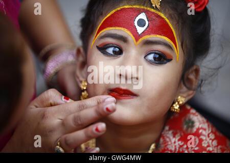 Kathmandu, Nepal. 14th Sep, 2016. A Nepalese girl dressed as a Kumari or living goddess gets ready to take part - Stock Photo