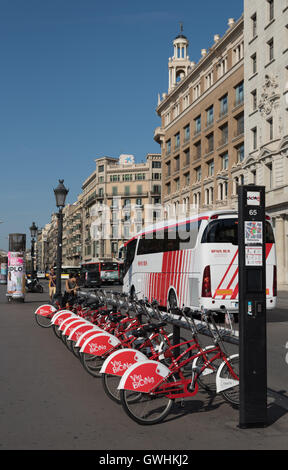 Bikes for hire in Barcelona city.  Bicing is a innovative bicycle rental scheme for local residents to cut down - Stock Photo