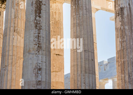 Detail of the fluted Doric columns of the Parthenon at the Acropolis in Athens, Greece - Stock Photo