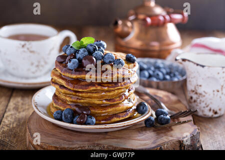Pumpkin pancakes with blueberries - Stock Photo