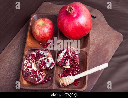 Rosh Ha Shana concept with pomegranates - Stock Photo
