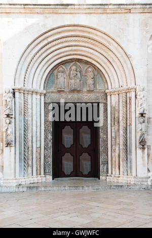 Detail of portal into Saint Anastasia Cathedral in Zadar, Croatia - Stock Photo