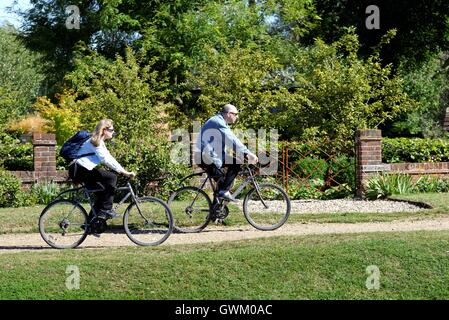 Two cyclists on towpath of the River Thames at Laleham Surrey - Stock Photo
