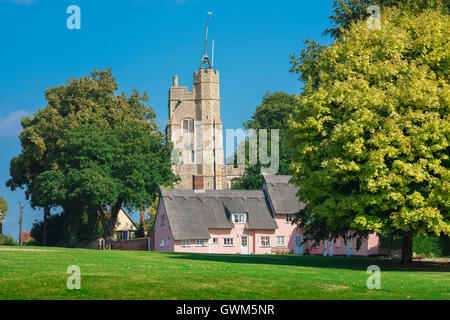Cavendish Suffolk, village green in Cavendish,Suffolk, with medieval church and row of pink cottages, England, UK - Stock Photo
