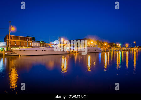 Buildings and boats along the waterfront at night, in Annapolis, Maryland. - Stock Photo