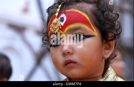 Kathmandu, Nepal. 14th Sep, 2016. A small girl dressed up as Living Goddess 'Kumari' gets ready for Kumari Puja - Stock Photo
