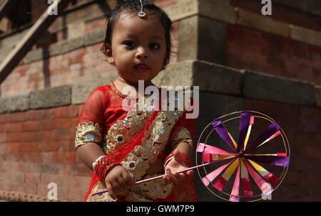 Kathmandu, Nepal. 14th Sep, 2016. A small girl gets ready for Kumari Puja procession organized prior to Indrajatra - Stock Photo