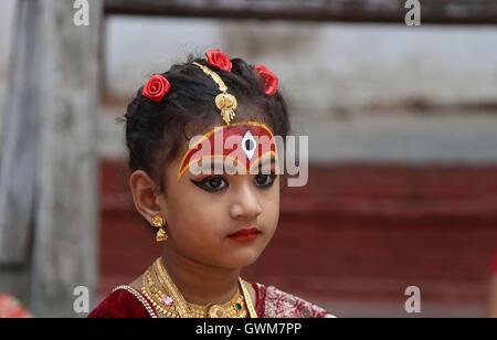 Kathmandu, Nepal. 14th Sep, 2016. A small girl dressed up as Living Goddess 'Kumari' attends Kumari Puja procession - Stock Photo