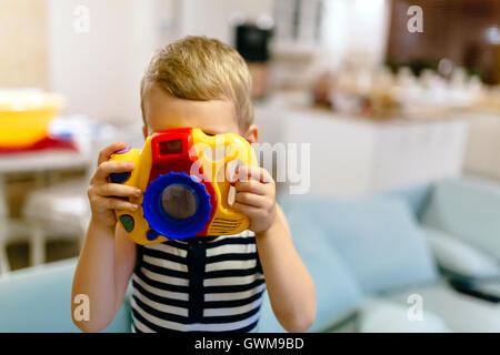 Cute boy wants to become photographer - Stock Photo
