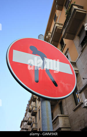 no entry sign with figure lifting it, street art, Milan, Italy - Stock Photo
