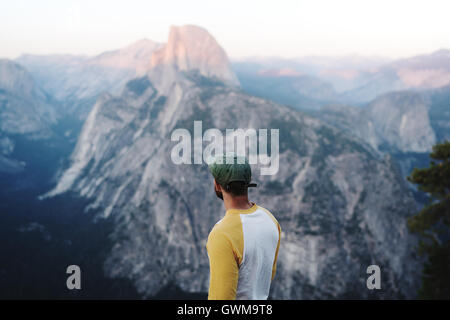 A hiker views Half Dome in California's Yosemite National Park - Stock Photo