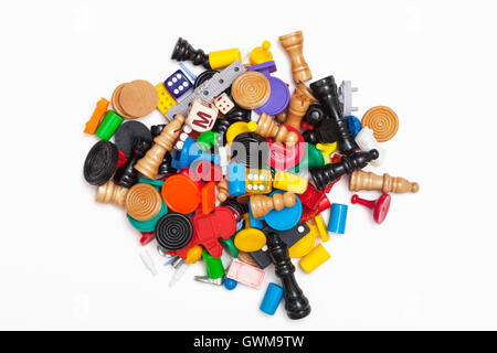 A pile of miscellaneous game pieces - Stock Photo