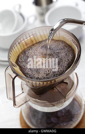 making hand drip coffee by paper filter - Stock Photo