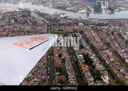 DDA Classic Flights Douglas DC-3 orbits over the city of Amsterdam. - Stock Photo