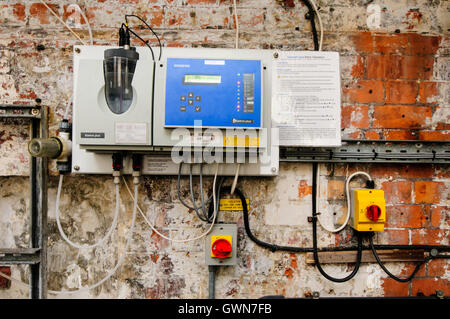 Siemens Swimming Pool Water Chemistry Controller in an old swimming pool - Stock Photo