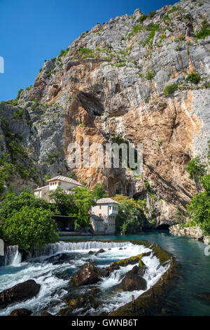 The karstic source of the Buna river at Blagaj and Derviche monastery (Tekke). Bosnia and Herzegovina. - Stock Photo