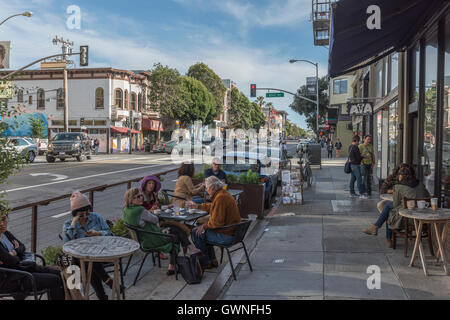 General street view on Valencia Street near the junction of 21st Street in the Mission District, San Francisco, - Stock Photo