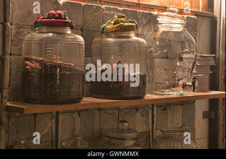 Jars of ya dong (Thai white spirits with medicinal herbs) at a bar in Bangkok, Thailand - Stock Photo