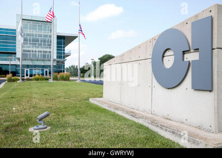 A logo sign outside of the headquarters of Owens-Illinois, Inc., in Perrysburg, Ohio on July 16, 2016. - Stock Photo