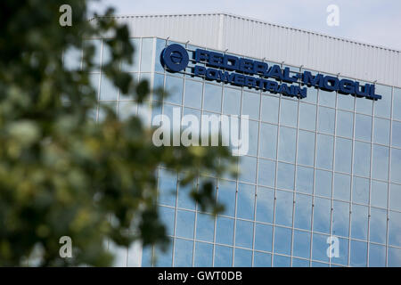 A logo sign outside of the headquarters of the Federal-Mogul Corporation in Southfield, Michigan on July 17, 2016. - Stock Photo