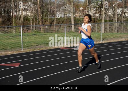 runner in track meet - Stock Photo
