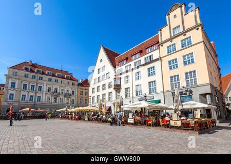 Tallinn, Estonia - May 2, 2016: Tourists in restaurants on Town Hall square in old Tallinn - Stock Photo