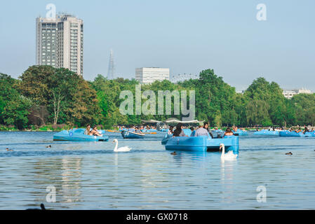 London summer tourists, on a summer afternoon a family of tourists enjoy a pedalo ride on the Serpentine Lake in - Stock Photo