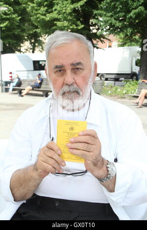 German celebrity hair sytlist Udo Walz showing his vaccination certificate as part of pro-vaccination initiative - Stock Photo