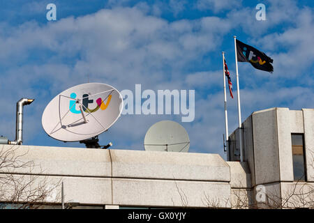 Satellite dish on top of Kent House, headquarters of British Television Channel ITV. - Stock Photo