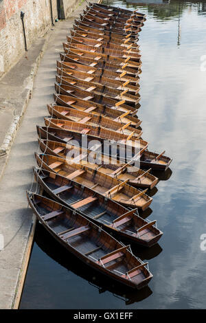 Wooden rowing boats moored up by Elvet Bridge on the river Wear in the city of Durham, England, UK - Stock Photo