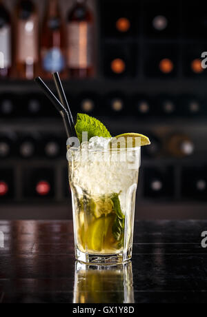 Mojito cocktail with lime and mint in highball glass - Stock Photo
