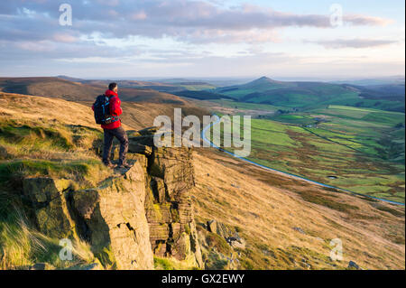 A walker stood on Shining Tor looking towards Shutlinsloe, Peak District National Park, Cheshire. - Stock Photo
