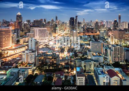 Bangkok city skyline at night - Skytrain train line & main tourist area around Sukhumvit showing Chit Lom and Phloen Chit Road, Pathum Wan District