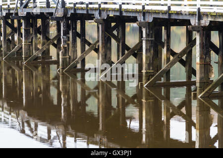Wooden structure Penmaenpool toll bridge, over the River Mawddach near Dolgellau, Wales, United Kingdom - Stock Photo