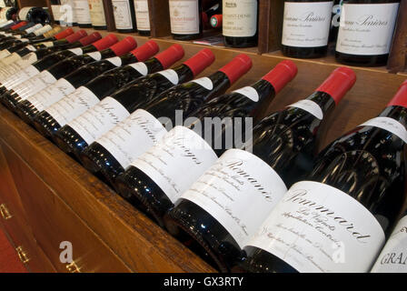 Variety of fine Burgundy wine bottles on display for sale at Jean-Luc Aegerter wine shop,  Beaune, Côte d'Or, France - Stock Photo