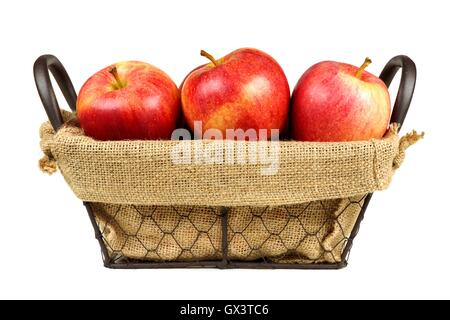 Fresh apples in a vintage wire basket with burlap isolated on a white background - Stock Photo