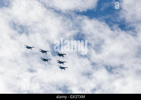 Russian Knights aerobatic team in the sky at an air show in Arkhangelsk in june 2015 - Stock Photo