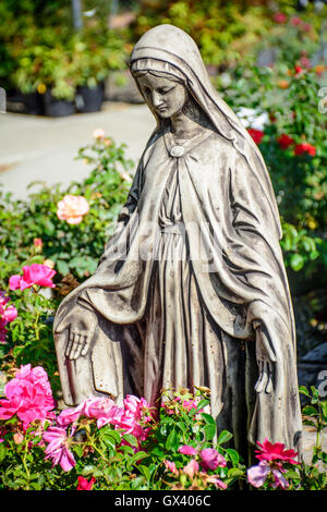 ... Mary Statue In The Garden With Flowers   Stock Photo
