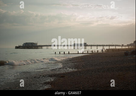 Worthing pier, beach and seafront during dusk on a summers evening in Worthing, West Sussex, England. - Stock Photo