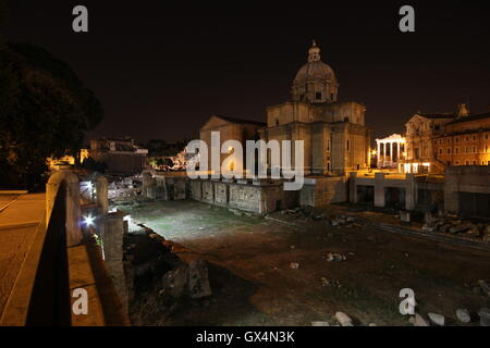 Forum of Caesar, Santi Luca e Martina Church in background, by night, Rome Italy - Stock Photo