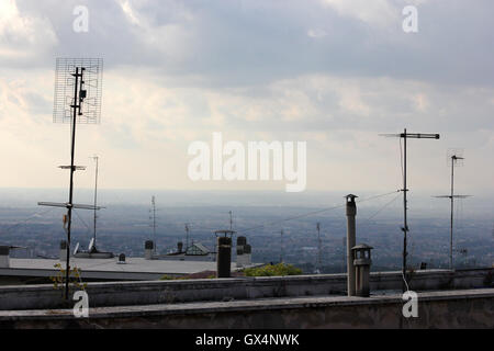 tv antennas on a rooftop, television aerials - Stock Photo