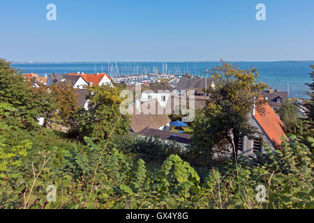 View of old thatched houses and the small harbour in beautiful fishing hamlet Sletten at Øresund  abt. 12 km south - Stock Photo