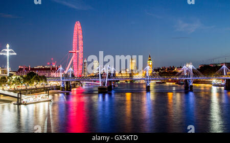 London Eye Skyline at Night From Waterloo Bridge London UK - Stock Photo
